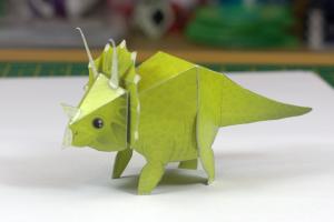 Dinosaur paper toy concept art